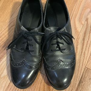Black wingtip Oxford shoes